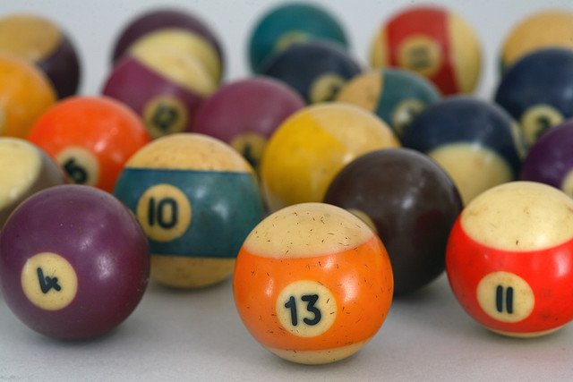 Billiard balls made of Bakelite, an early form of plastic.