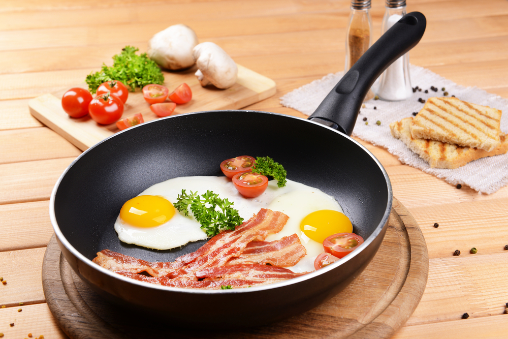 Why does Teflon stick to the metal pan but not food?