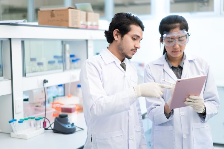 scientists-recording-results-using-tablet